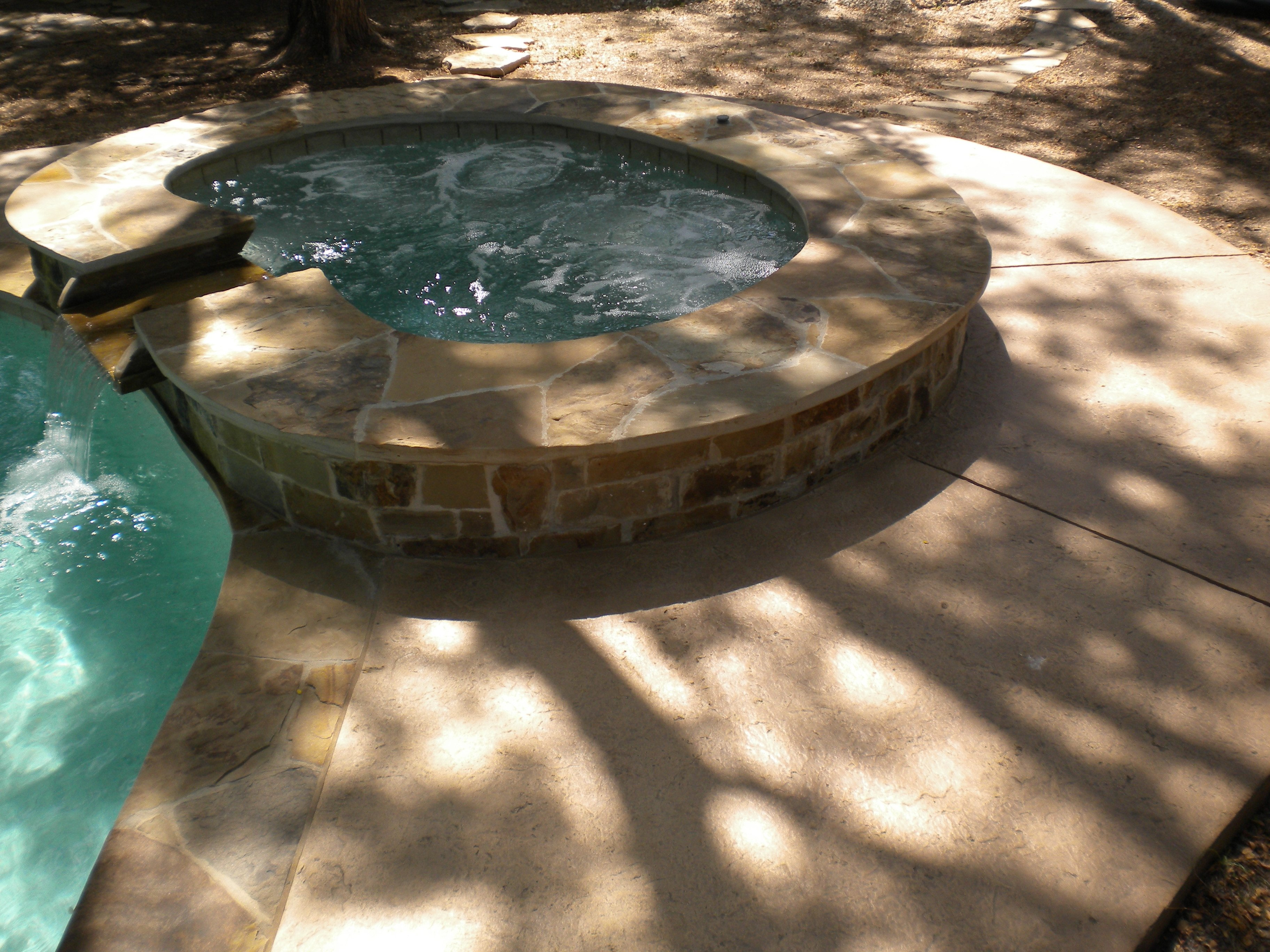 Raised Spa with Flagstone Coping and Veneer