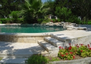Exposed Pool Side Wall with Limestone Veneer and Grey Bottom.