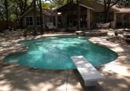 Pool and Spa with Flagstone Coping and Patterned Concrete Deck