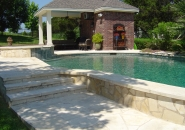 Pool and Spa with Limestone Wall and Deck