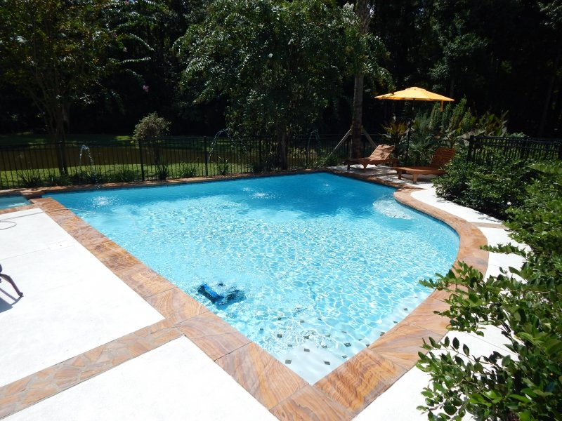 Dallas Display Pool with Deck Jets and Robotic Cleaner