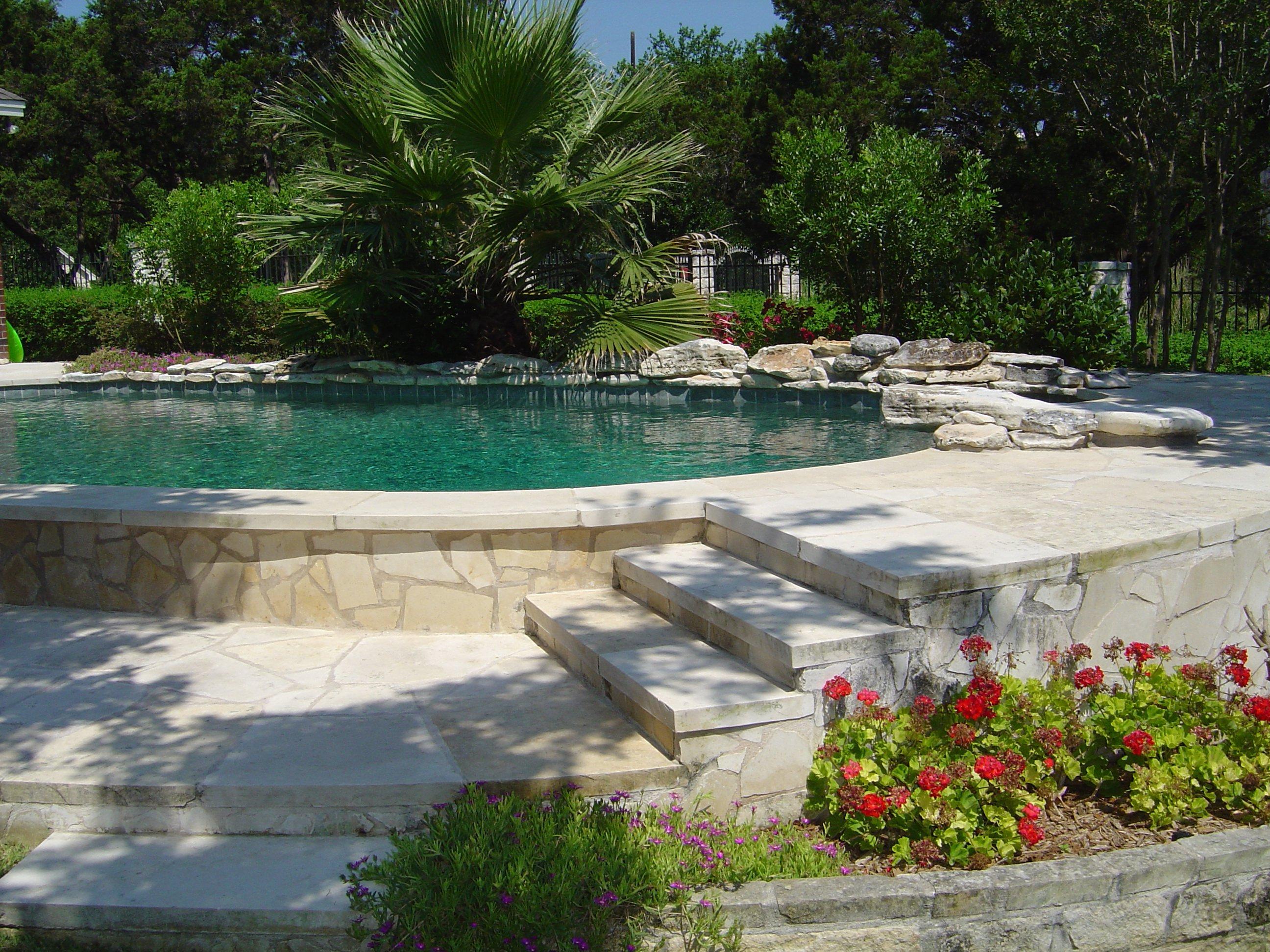 Exposed Pool Side Wall with Limestone Veneer and Grey Bottom.