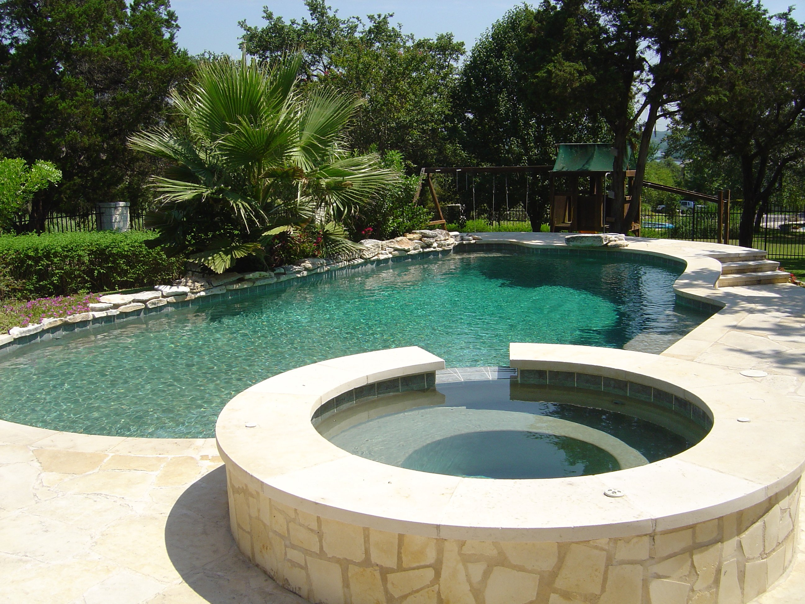 Pool and Spa with Limestone Deck