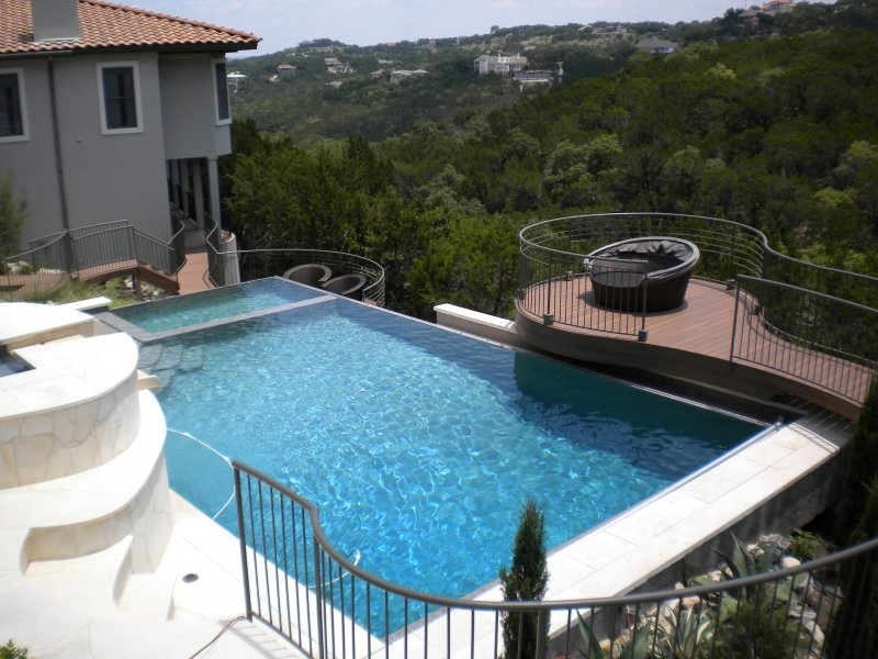 Pool with Spa raised 5ft., Negative Edge with PebbletTech finish and two Automatic Covers