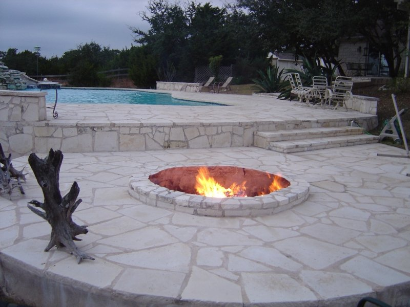 Ranch Setting Pool with Stone Deck and Fire Pit