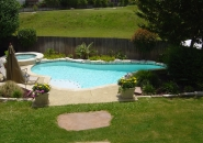 Pool and Spa with Sun Shelf and Fieldstone Border